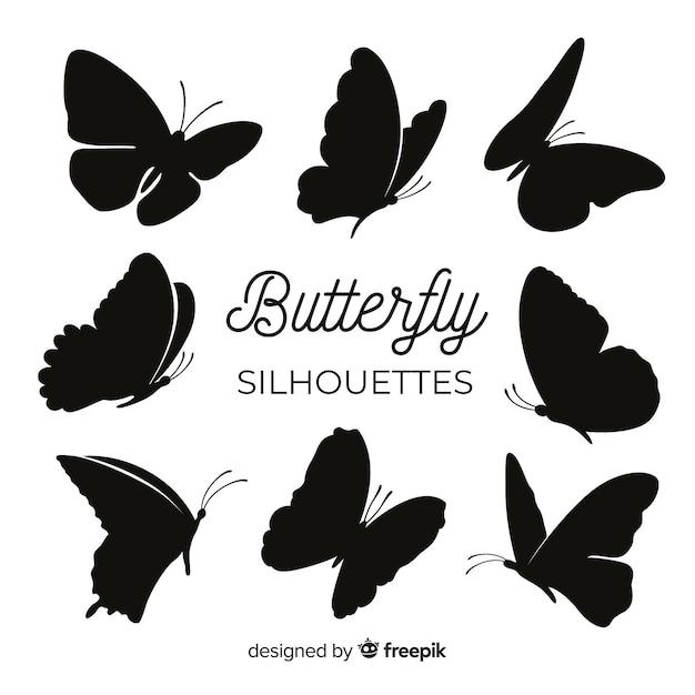 Silhuetas de borboleta voando Vetor grátis