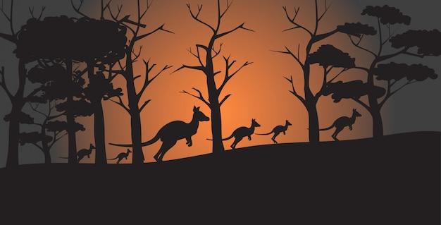 Silhuetas de cangurus correndo de incêndios florestais na austrália animais morrendo no conceito de desastre natural de incêndio florestal horizontal Vetor Premium