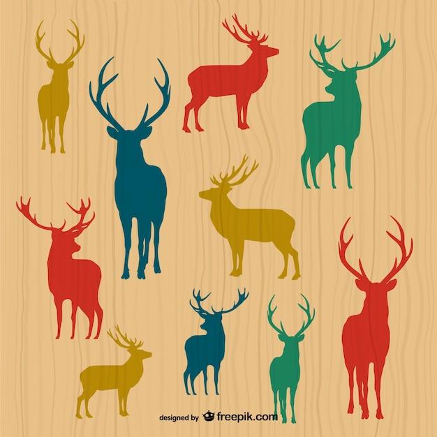 Silhuetas dos cervos Vetor Premium