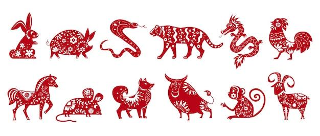 Símbolos de animais do zodíaco chinês isolados em um conjunto branco de ilustrações Vetor Premium