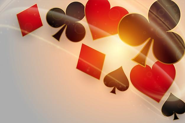 Símbolos de cartas de jogar cassino com luz brilhante Vetor grátis