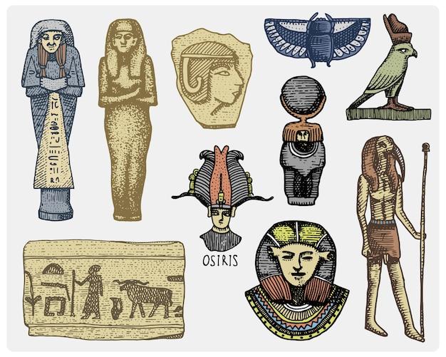 Símbolos egípcios, cabeça de faraó, scorob, hieróglifos e osíris, vintage de deus, gravada mão desenhada no esboço ou madeira cortada estilo, velho olhando retrô, ilustração realista isolada. Vetor Premium