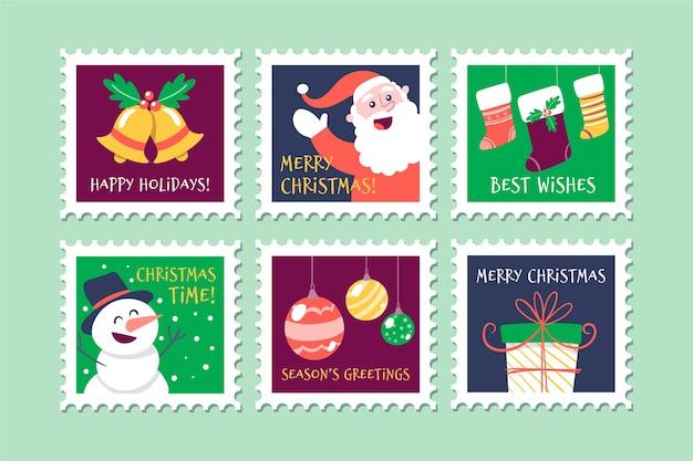 Símbolos tradicionais na coleção de selos de natal Vetor grátis