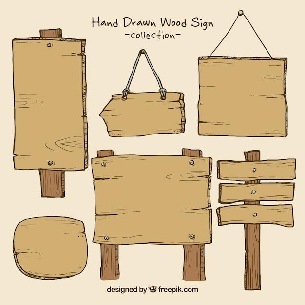 Sinais de madeira com pregos embalar Vetor grátis