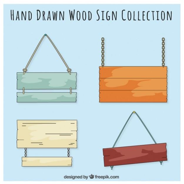 Sinais de madeira desenhado mão Vetor grátis