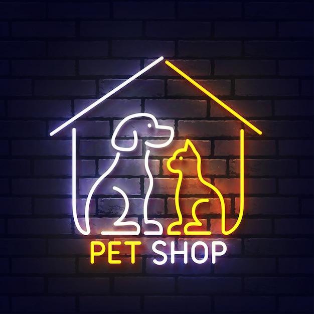 Sinal de néon da loja de animais. indicador de luz de néon brilhante da casinha de cachorro e gato. sinal de pet shop com luzes de néon coloridas isoladas na parede de tijolos. Vetor Premium