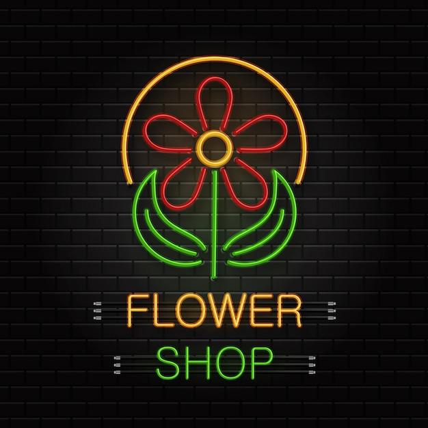 Sinal de néon de flor para decoração no fundo da parede. logotipo de néon realista para floricultura. conceito de loja de flores e profissão de florista. Vetor Premium