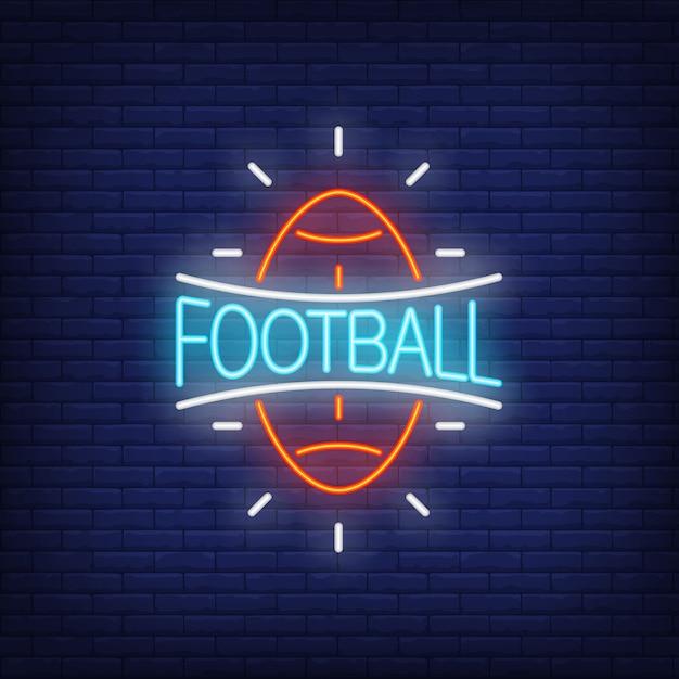 Sinal de néon de futebol. forma da bola de rugby no fundo da parede de tijolo. Vetor grátis