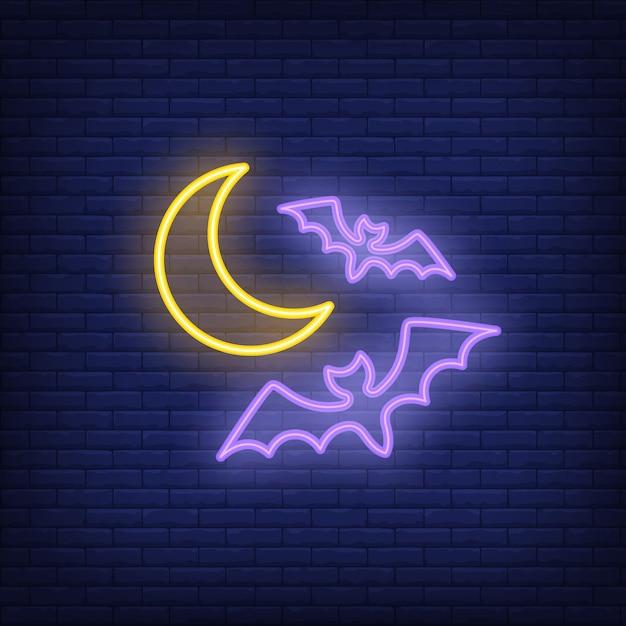 Sinal de néon de morcegos voando Vetor grátis