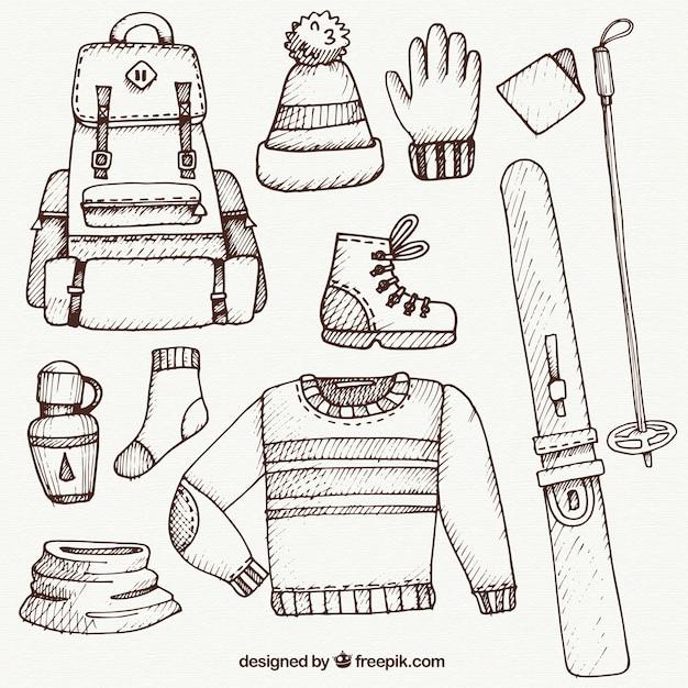 Ski roupas e acessórios pacote esboço Vetor grátis