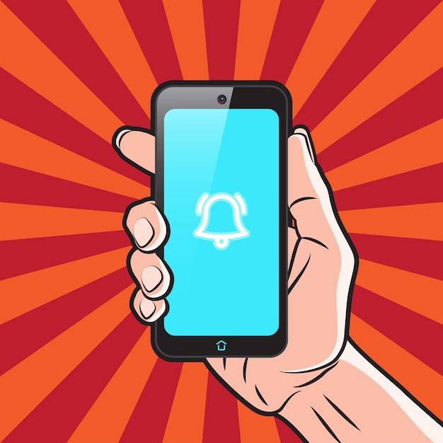 Smartphone na mão com ícone de alarme na tela Vetor Premium