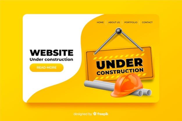 Sob design plano de página de destino de construção Vetor grátis