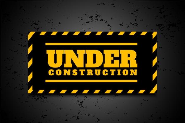 Sob fundo industrial de construção em listras pretas amarelas Vetor grátis
