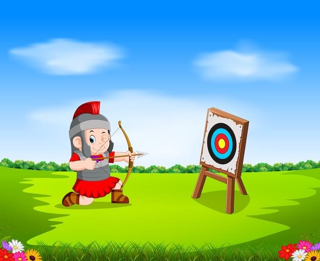 Soldado romano com arco e alvo Vetor Premium