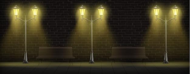 Streetlights iluminação no fundo da parede de tijolo Vetor grátis