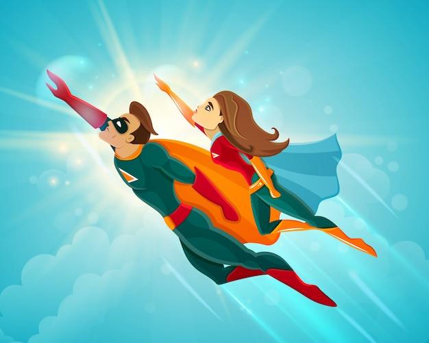 Super heróis casal voando Vetor grátis