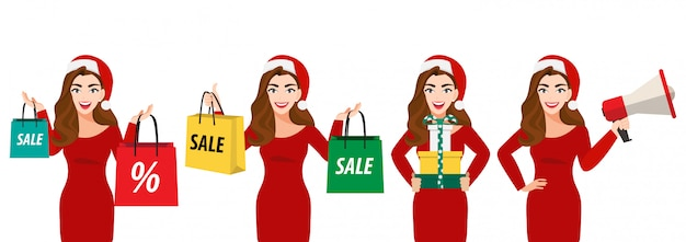 Surpresa natal mulher bonita no chapéu de papai noel com sacola de compras, caixa de presente e megafone Vetor Premium