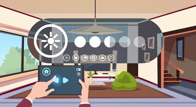 Tabuleta de digitas do uso da mão com automatização esperta home do app sobre a tecnologia moderna interior da sala de visitas do conceito da monitoração da casa Vetor Premium
