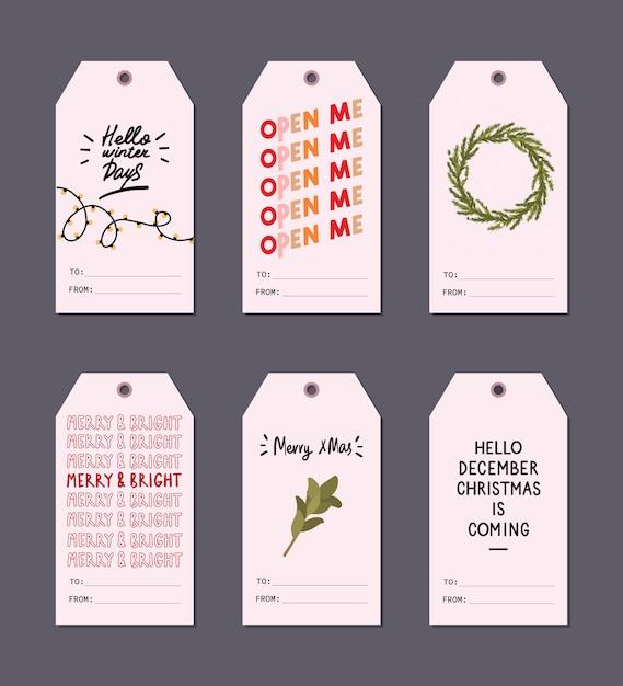 Tags de presente de saudação de natal conjunto com elementos de inverno e desejos de letras de férias Vetor Premium