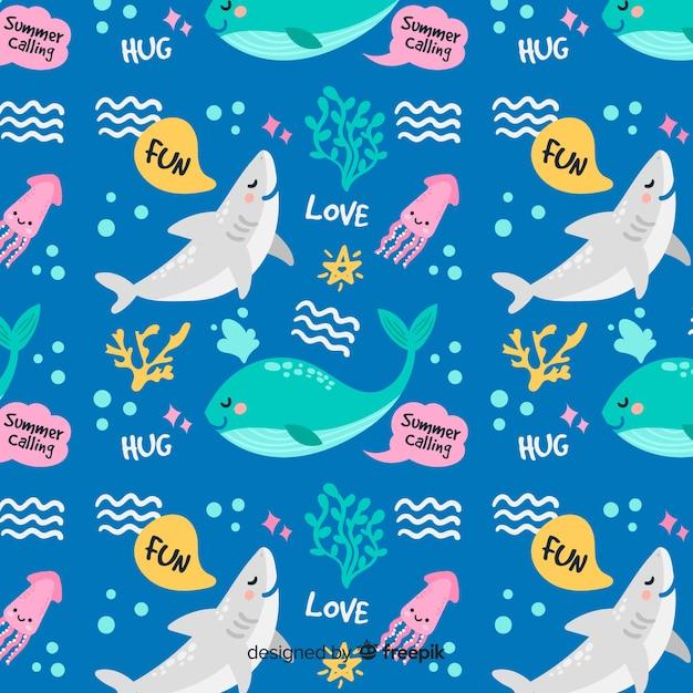 Teste padrão colorido dos animais e das palavras de mar do doodle Vetor grátis