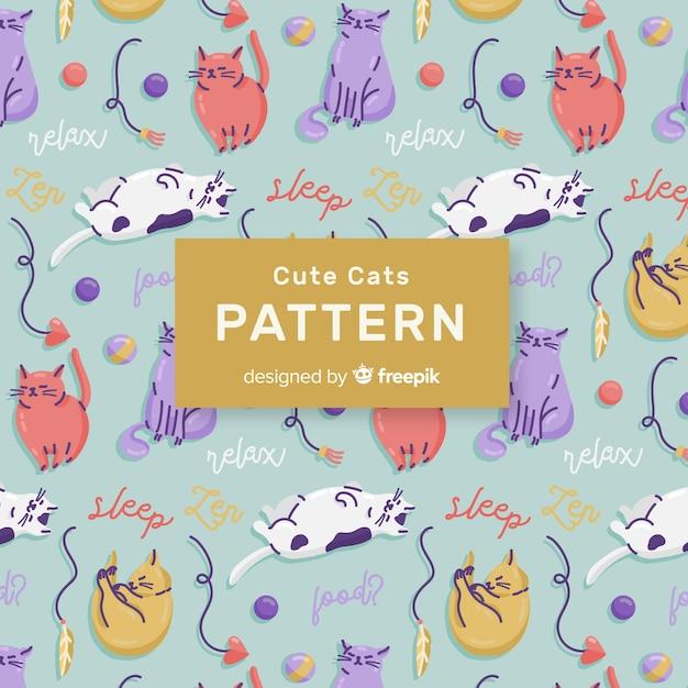 Teste padrão colorido dos gatos e das palavras do doodle Vetor grátis