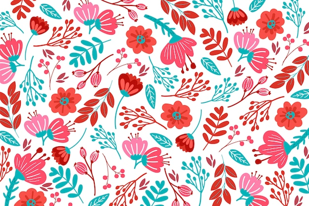 Teste padrão floral desenhado mão em tons vermelhos Vetor grátis
