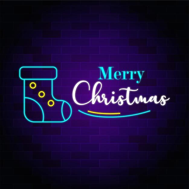 Texto de néon de feliz natal com meia de natal premium Vetor Premium