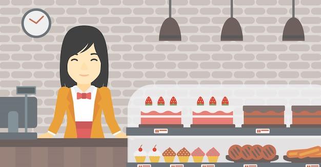 Trabalhador de pé atrás do balcão da padaria. Vetor Premium