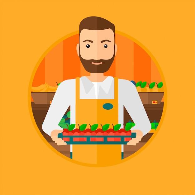 Trabalhador de supermercado com caixa cheia de maçãs. Vetor Premium