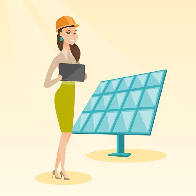 Trabalhadora da usina de energia solar. Vetor Premium