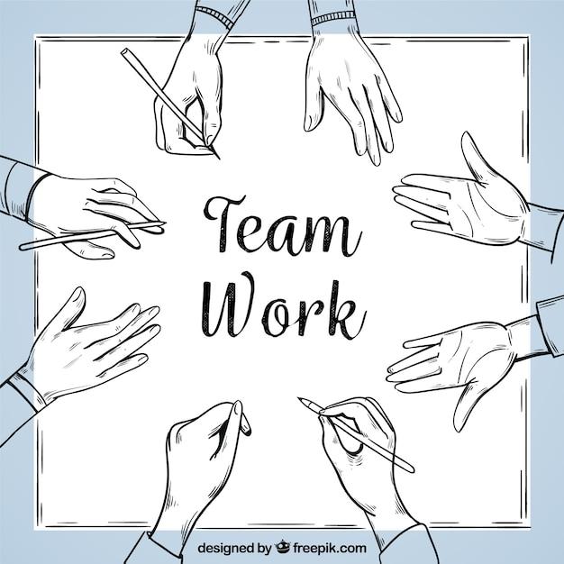 Trabalho em equipe de fundo em estilo desenhado a mão Vetor grátis