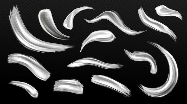 Traçados de pincel prateado, manchas de tinta de metal, manchas de textura metálica de cor cinza ou branca Vetor grátis