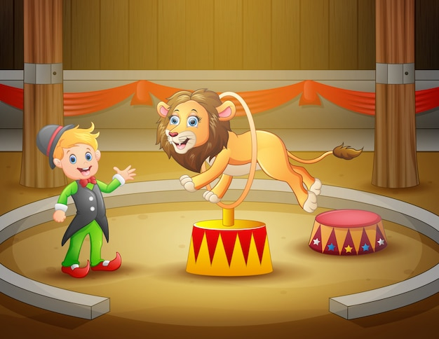 Treinador de circo realiza um truque junto com o leão na arena Vetor Premium