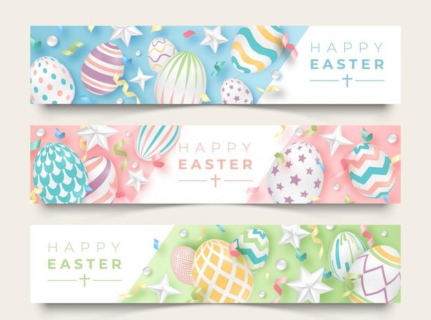 Três banners horizontais de páscoa com ovos decorados realistas, fitas, estrelas e bolas. Vetor Premium