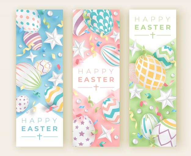 Três banners verticais de páscoa com ovos decorados realistas, fitas, estrelas e bolas Vetor Premium