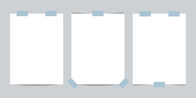 Três cartões de visita com fita adesiva em fundo cinza Vetor Premium