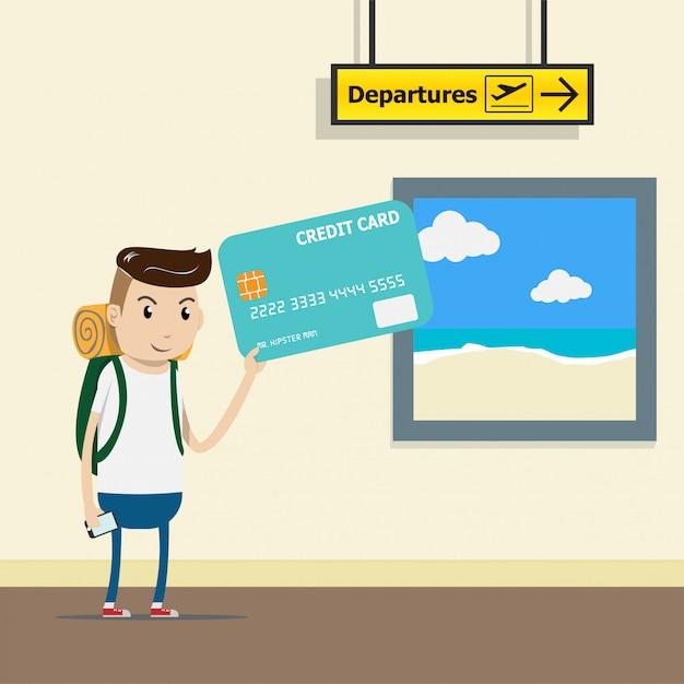 Turista com mochila no terminal do aeroporto com cartão de crédito na mão Vetor Premium