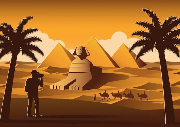 Turista tirar foto do famoso lugar chamado pirâmide Vetor Premium