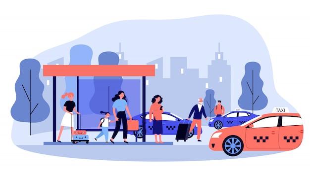 Turistas com bagagem esperando táxi Vetor Premium