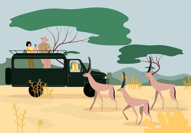 Turistas que conduzem o jipe no safari em áfrica. savana Vetor Premium