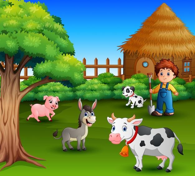 Um agricultor em sua fazenda com um monte de animais de fazenda Vetor Premium