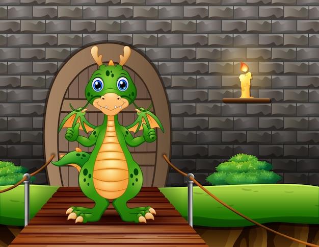 Um dragão aparecendo polegar e parado na ponte pênsil Vetor Premium
