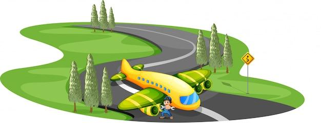 Um garoto com um avião pousando na longa estrada sinuosa Vetor grátis