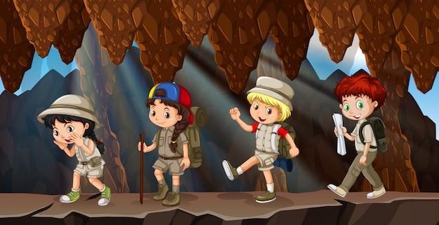 Um, grupo crianças, hiking, em, caverna Vetor Premium