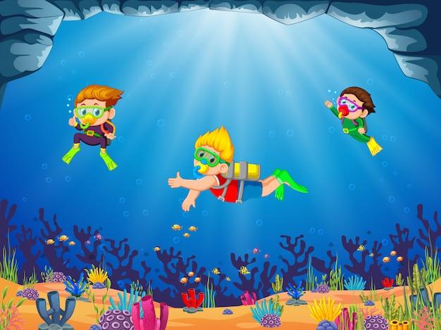 Um grupo de crianças está mergulhando com seu amigo com diferente posando Vetor Premium