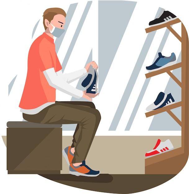 Um homem tentando sapatos novos na loja de sapatos Vetor Premium