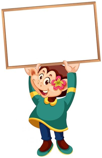 Um macaco bonito segurando bandeira em branco Vetor grátis