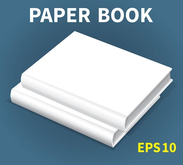 Um mock-up de dois livros brancos deitado sobre uma mesa Vetor Premium