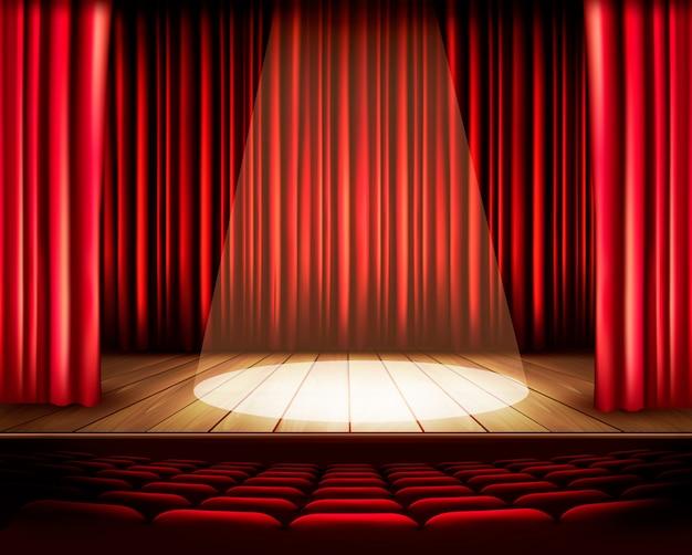 Um palco de teatro com uma cortina vermelha, assentos e um holofote. Vetor Premium