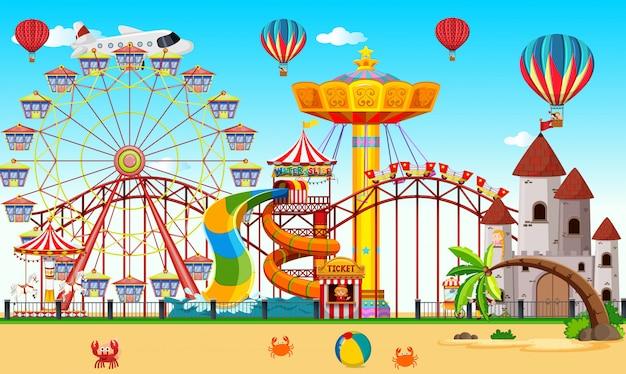 Um parque de diversões ao lado da praia Vetor Premium
